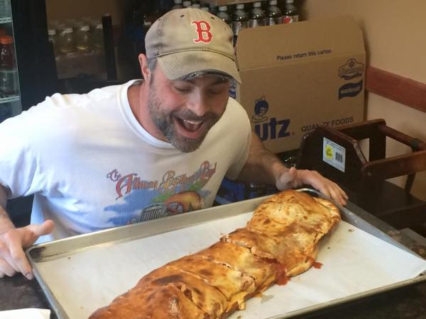 Geoff getting a look at the calzone.