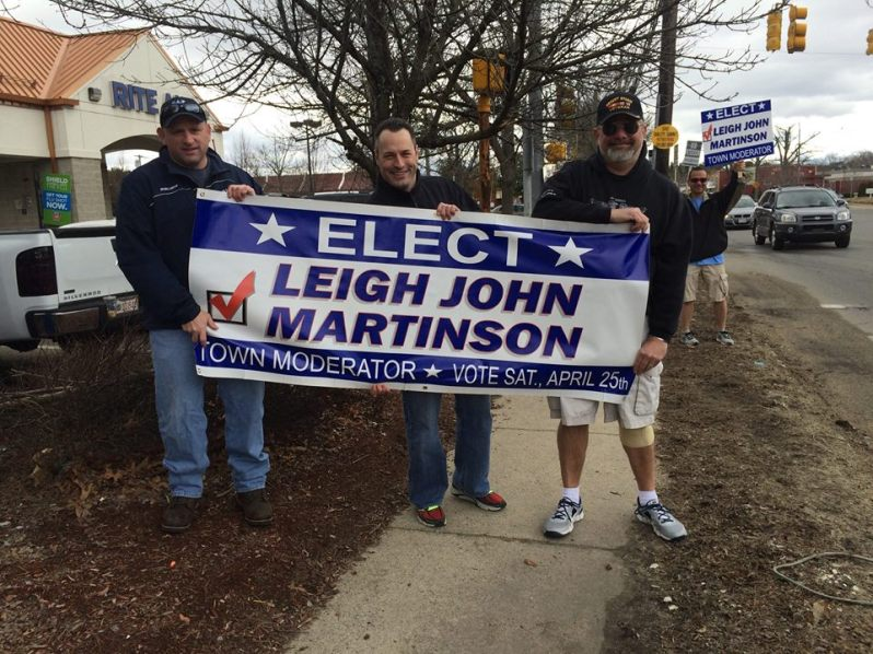 Mike Newhouse & Lou Cimaglia holding signs for Leigh Martinson. (Photo from Martinson's Facebook campaign page)