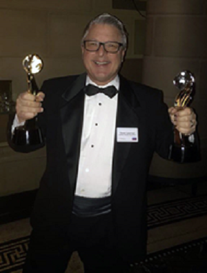 Steve Lassman, Vice President of Villa Product & Agency Relations for Villas of Distinction accepts the Travvy Award